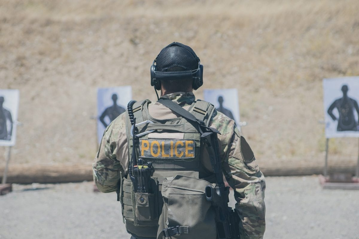 Police officer practicing shooting at a target range
