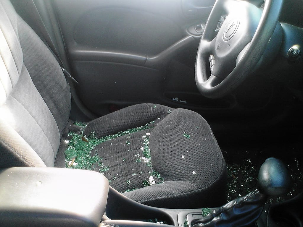 Broken glass in a car front seat