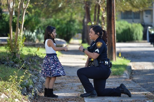 SAPD officer with young girl