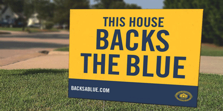 This house backs the blue