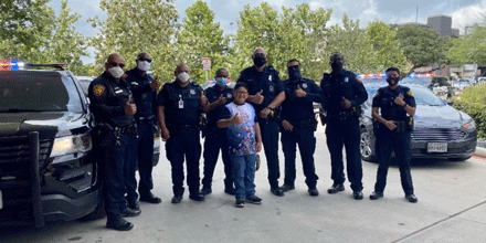 Kid in front of police