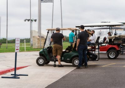 Participants in golf carts