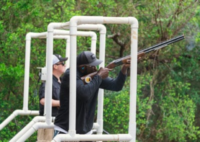 Holding shotgun